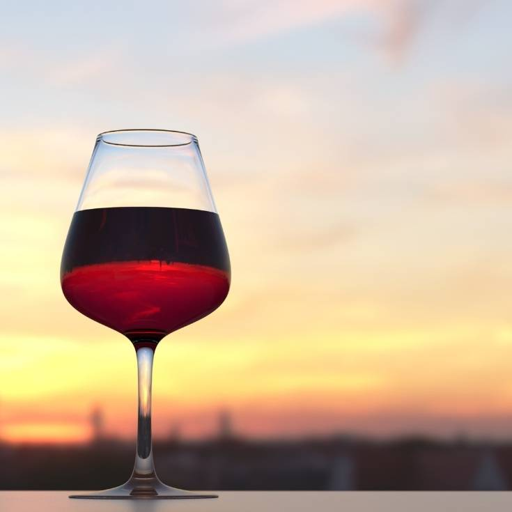 red wine in a glass at sunset