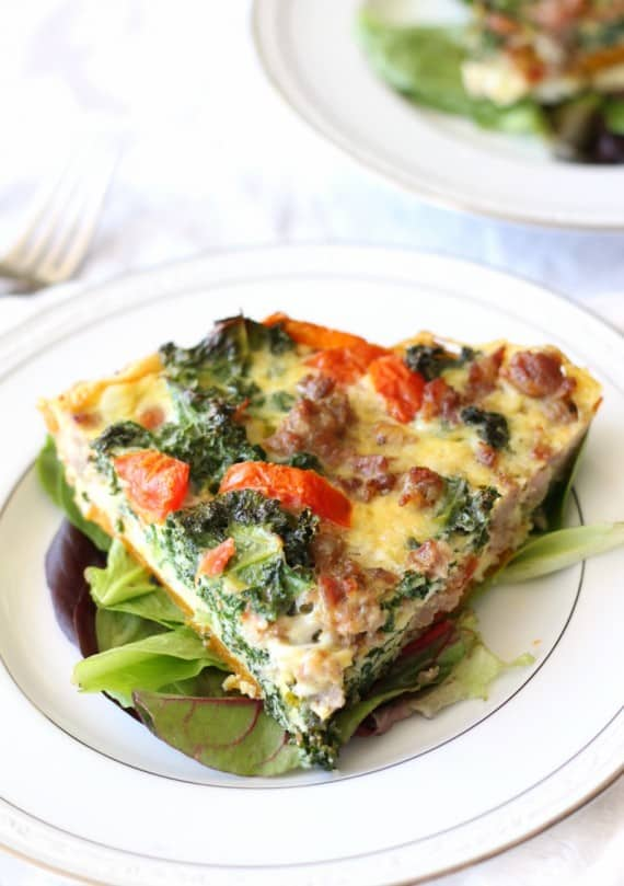 Butternut crusted quiche with sausage kale and tomatoes