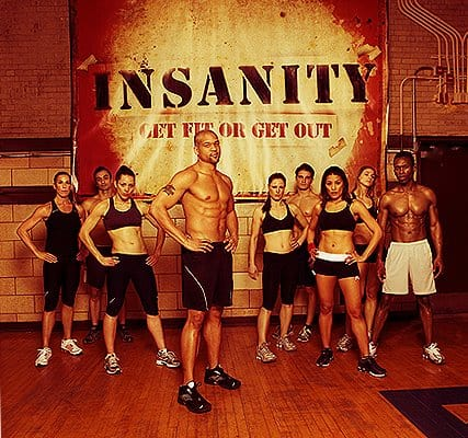 insanity workout review with Shaun T and cast in photo on the set