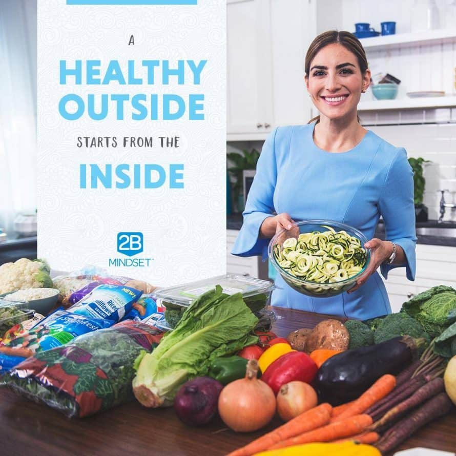 Woman holding healthy foods and text that says A healthy Outside Starts Inside