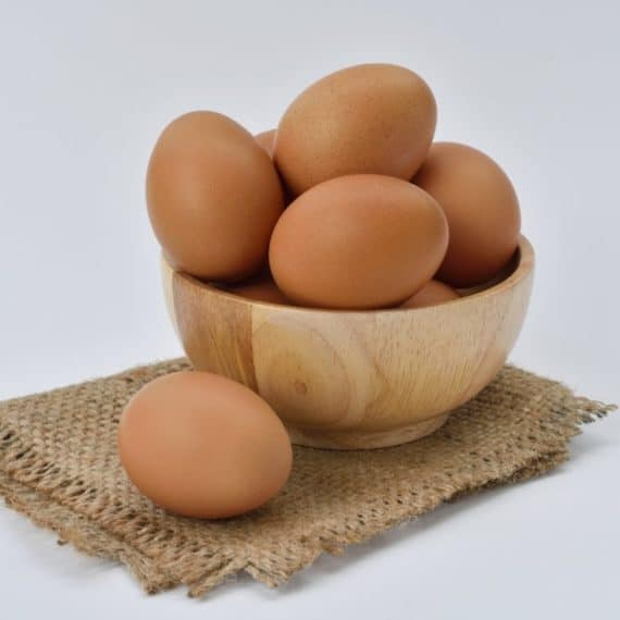 brown eggs in a wooden bowl