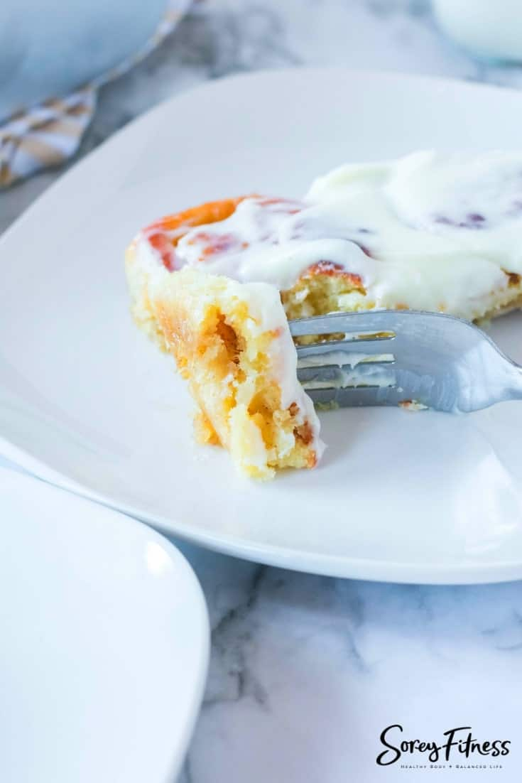 taking a bite of the low carb cinnamon roll recipe
