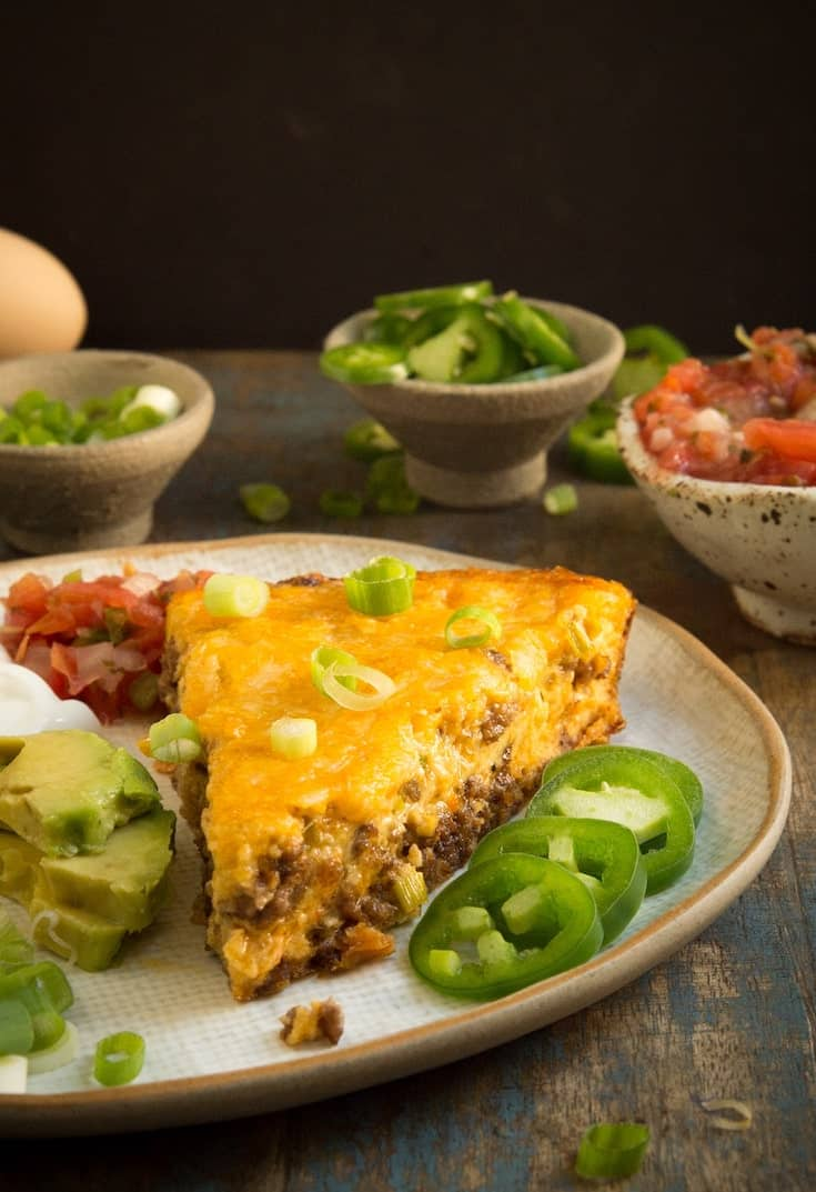 Crustless taco pie with jalapeños, avocado and salsa is one of our favorite keto ground beef recipes