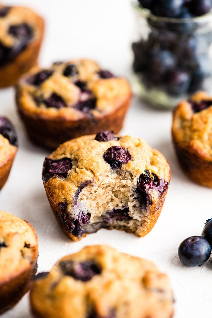 blueberry muffin with a bite taken from it