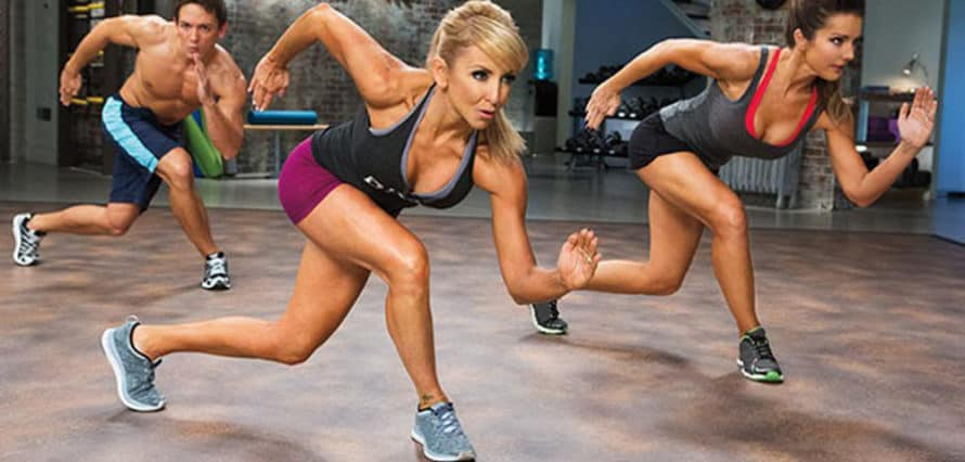 Chalene Johnson and cast doing a PiYo lunge