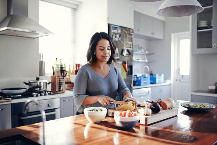 Women meal prepping her food on the Noom Diet Plan