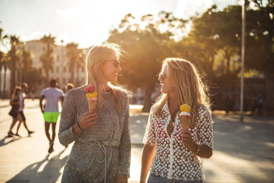 Two girls eating ice cream cones