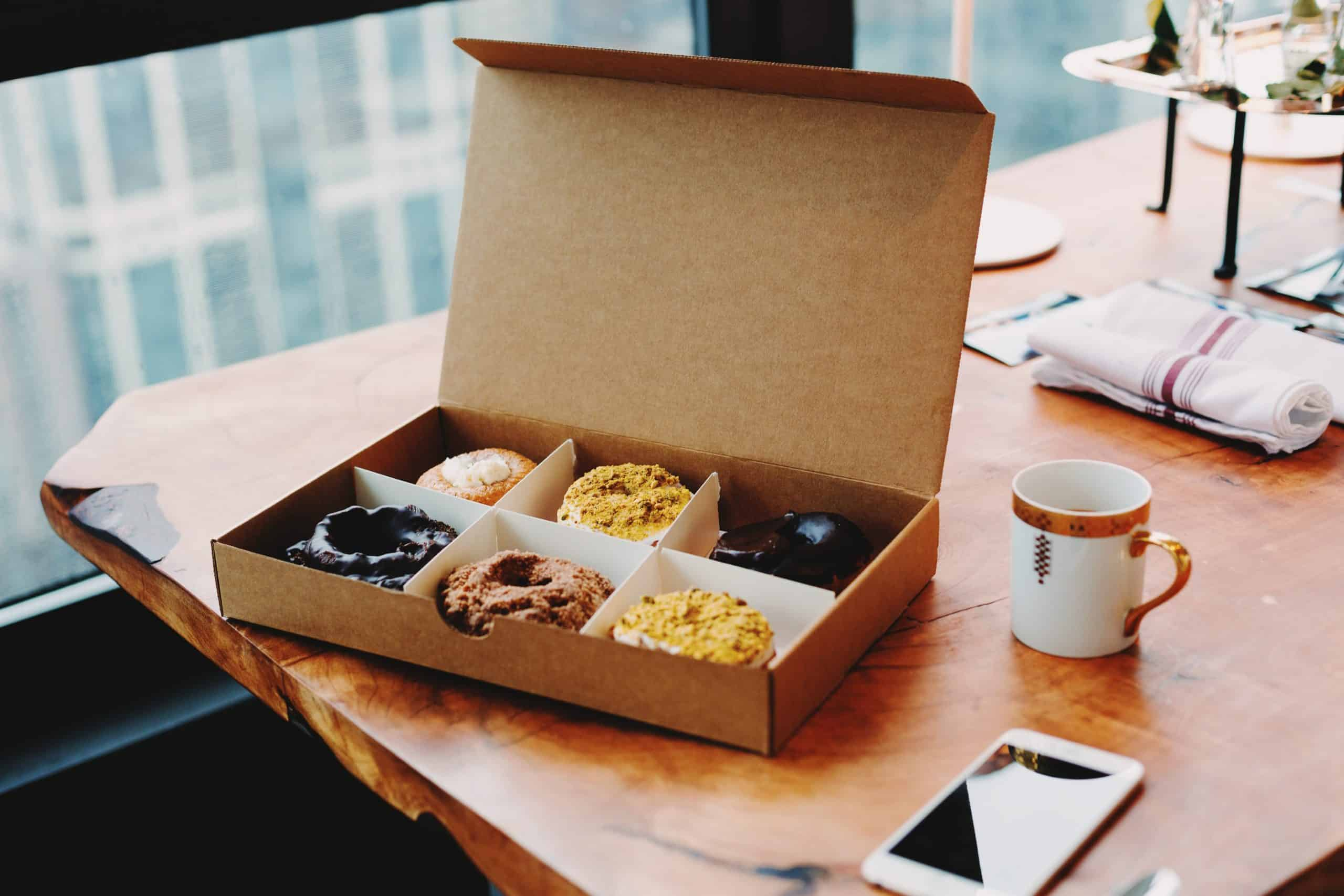Box of donuts sitting on a desk