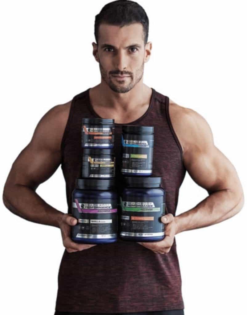 Joel holds 10 Rounds Beachbody Supplements