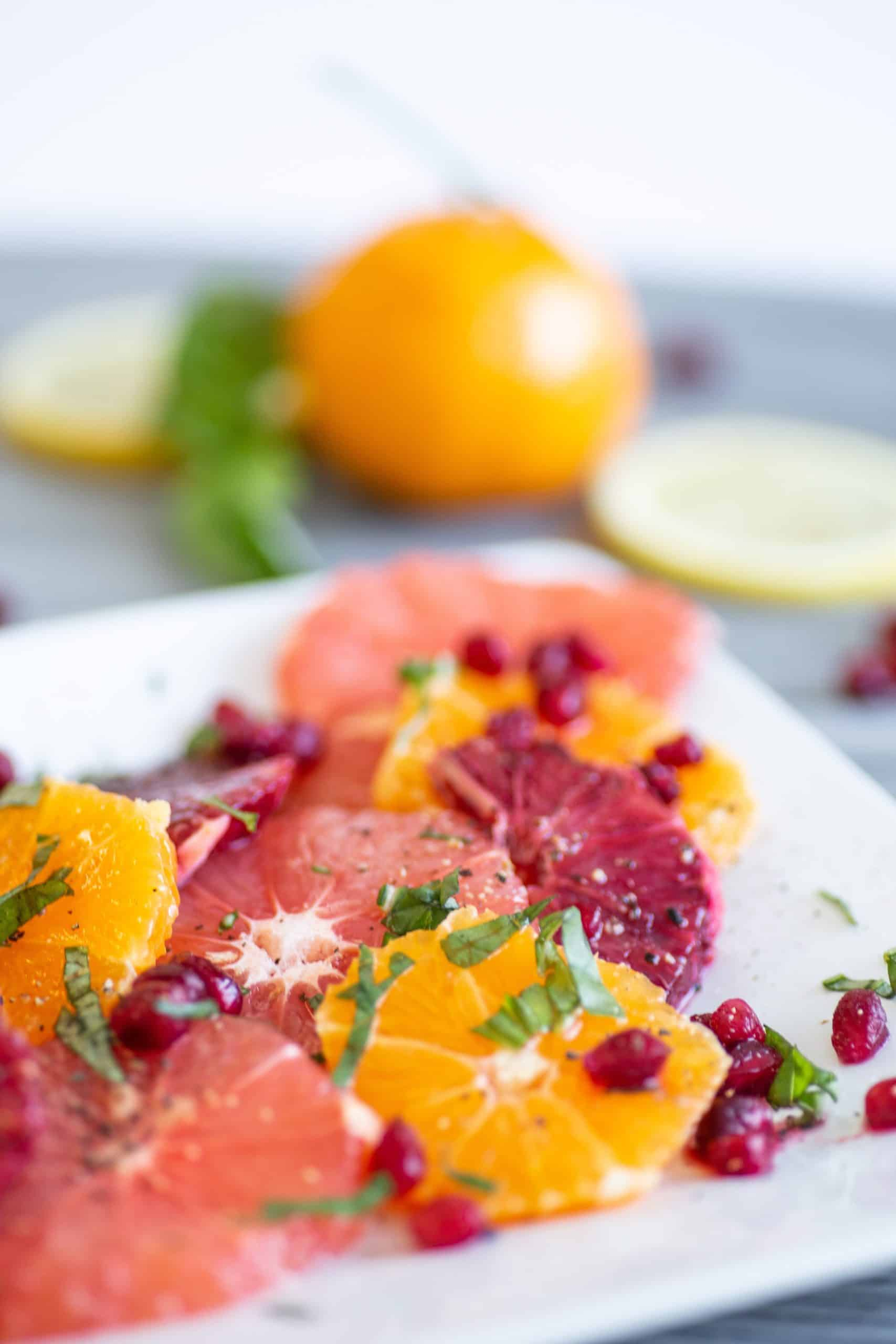 grapefruit salad on a white plate