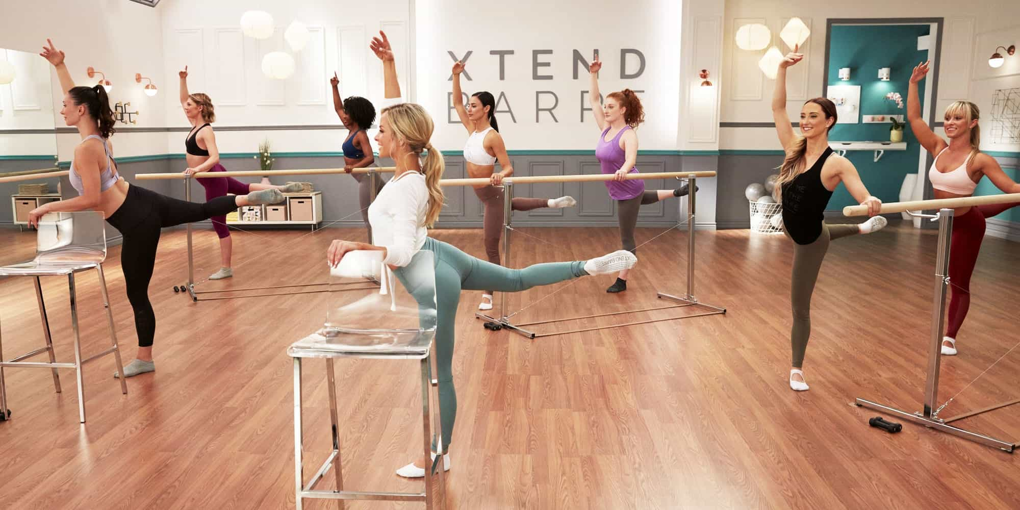 Andrea Leigh Rogers leading an Xtend Barre Class