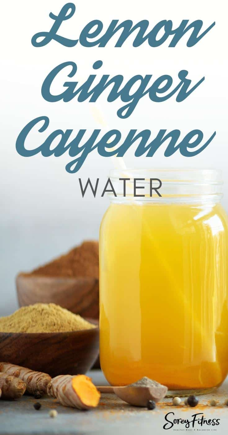 """Mason jar with water in it with the text overlay """"Lemon Ginger Cayenne Water"""""""