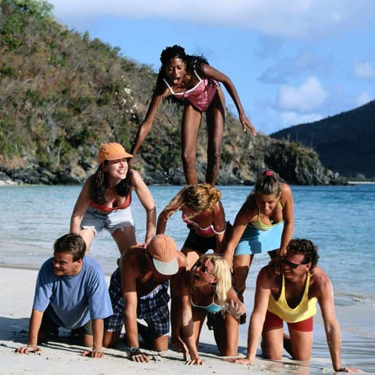 people doing a pyramid on a beach