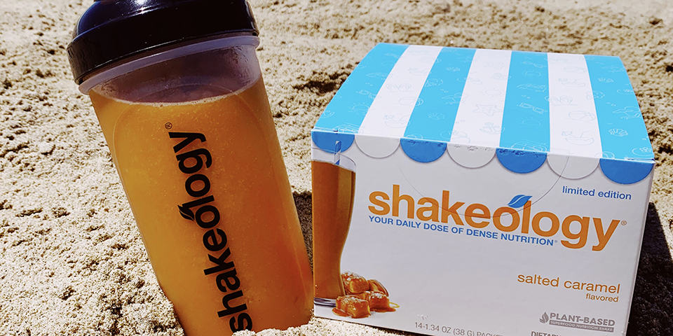 caramel shakeology in a shaker cup with the box of next to it