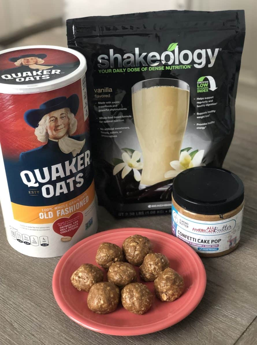 Shakeology Protein Balls with ingredients behind them