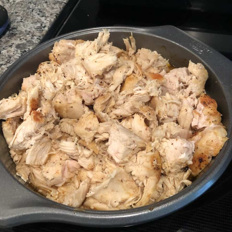 Chicken cooked and pulled apart