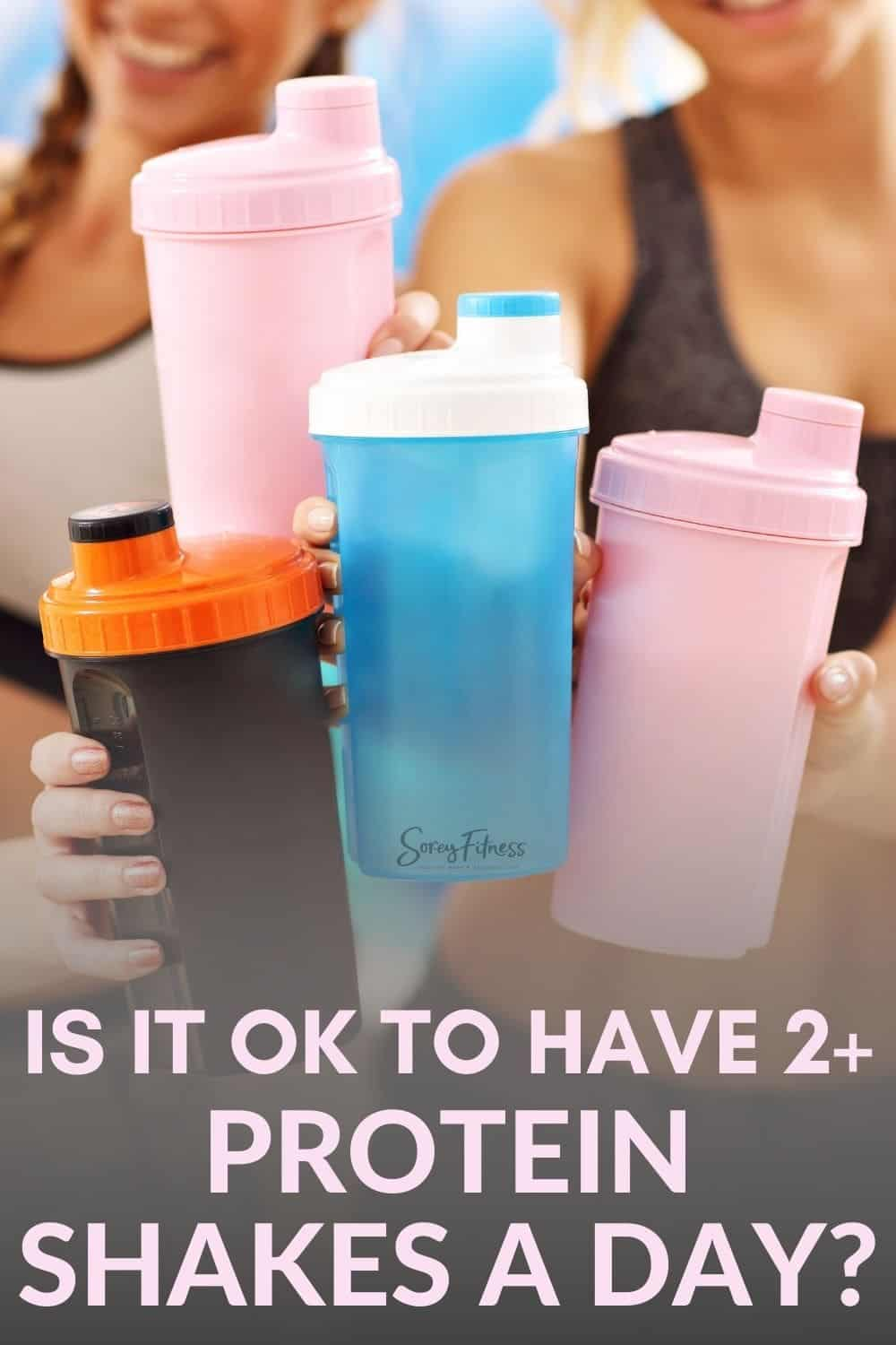 "women doing a cheers with protein shaker cups with the text overlay ""is it okay to have 2 protein shakes a day?"""