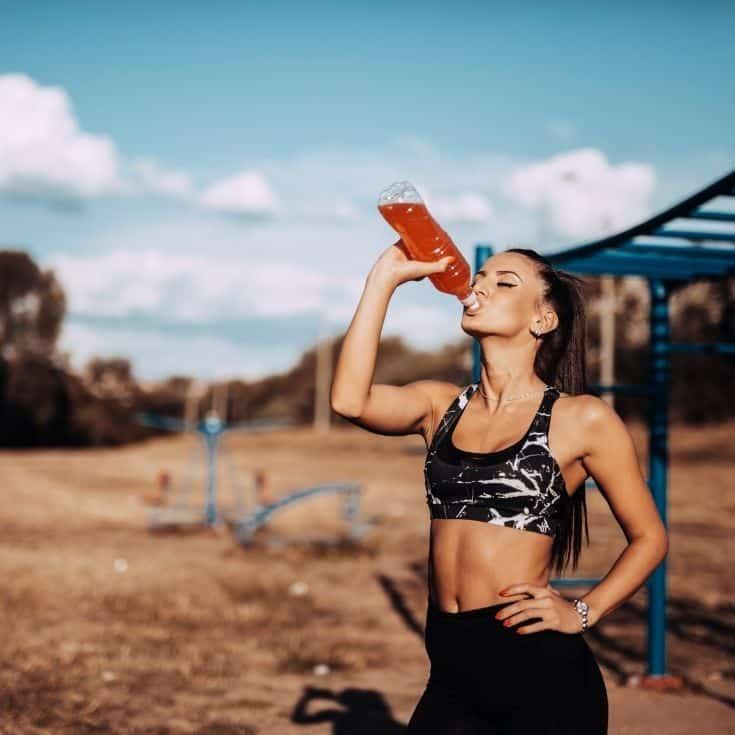woman drinking a popular sports drink
