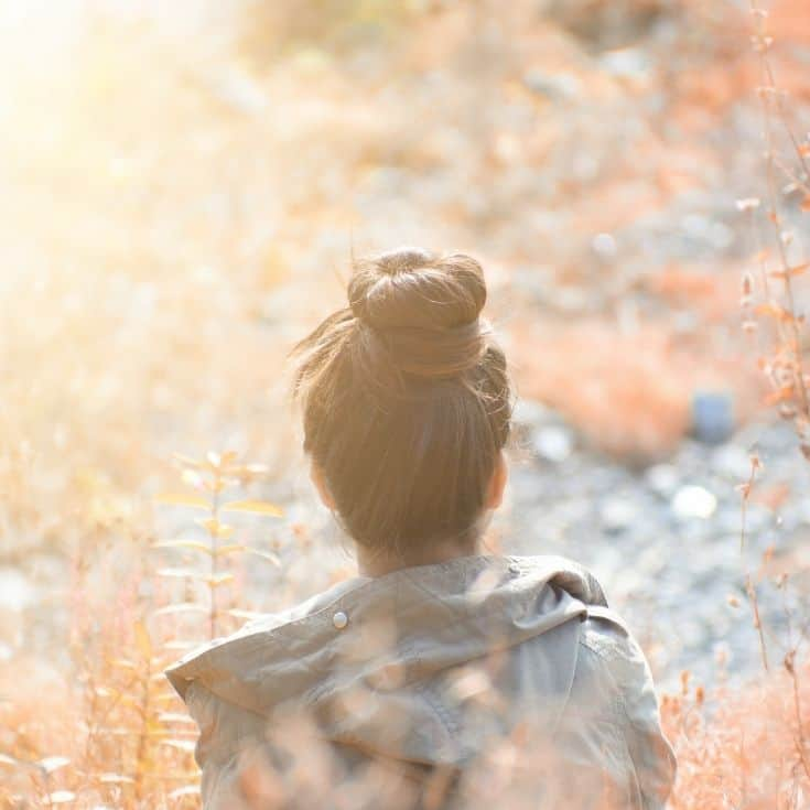 back of a woman's head in nature
